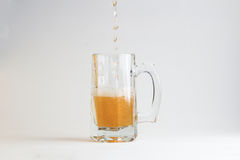 Glass of beer  on white background Royalty Free Stock Photography