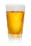 Glass of beer on white. Glass of fresh cold beer with ice crystals isolated on white background, clipping path included stock photography