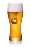Glass of beer on white Stock Photo