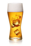 Glass of beer on white Stock Image