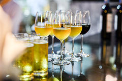 Glass of beer, wine and champagne in a bar. Close up of a glass of beer, wine and champagne in a bar. Many glasses of different alcohol drink in a row on bar Stock Photo