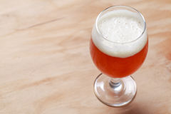 Glass of beer on wood Stock Images