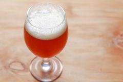 Glass of beer on wood Royalty Free Stock Image