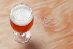 Glass of beer on wood Stock Photo