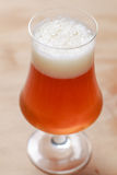 Glass of beer on wood Royalty Free Stock Photo