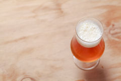 Glass of beer on wood Royalty Free Stock Photos