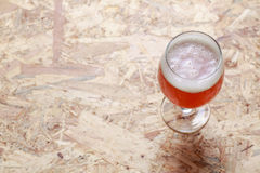 Glass of beer on wood Stock Photography