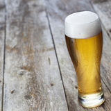 Glass beer on wood background Stock Image