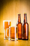 Glass beer. Glass beer on wood background Royalty Free Stock Image