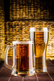 Glass beer. On wood background Stock Images