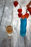 Glass beer on wood background. physalis Stock Photo