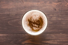 Glass of beer on a wooden background. Top view Royalty Free Stock Image
