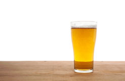 Glass of beer on wooden bar isolated Royalty Free Stock Images