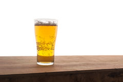 Glass of beer on wooden bar isolated Stock Image