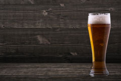 Glass of beer. On a wooden countertop Royalty Free Stock Photography