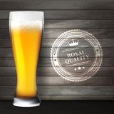 Glass of beer on wooden surfaces Royalty Free Stock Photos