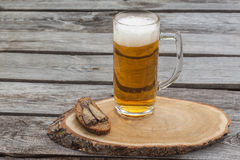Glass of beer  on a wooden table Stock Images