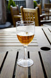 Glass of beer on a wooden table, outdoor patio Royalty Free Stock Images