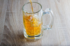Glass of beer on a woody background Stock Images