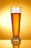 Glass of beer on a yellow Stock Photo