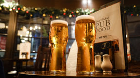 Glass of beers on a local pub. Low angle view royalty free stock images