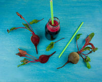 Glass of beet juice with beets on wooden table close up Royalty Free Stock Photo