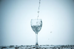 Glass being filled with water Royalty Free Stock Images