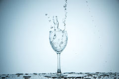 Glass being filled with water Stock Images