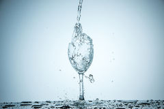 Glass being filled with water Royalty Free Stock Image
