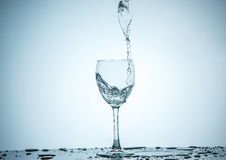 Glass being filled with water Stock Image