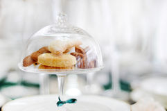 Glass bell jar and cookies Stock Photo