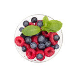 Glass of berries isolated on white background top view flat lay. Ripe Sweet Raspberry, Blueberry, Mint Stock Photography