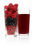 Glass with berries and juice Royalty Free Stock Photography