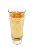 Glass with beverage. Fizzy beverage in tumbler over white Royalty Free Stock Image