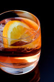 Glass of beverage with ice Royalty Free Stock Images