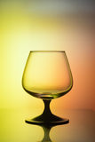 Glass in bicolor light. Empty glass in bicolor light Stock Photos