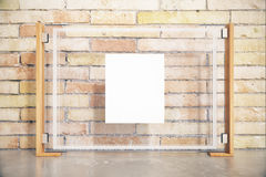 Glass billboard front. Front view of glass billboard with white insert on brick wall. Mock up, 3D Render Royalty Free Stock Images