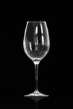 Glass on Black. Red wine glass isolated over a black background royalty free stock photos