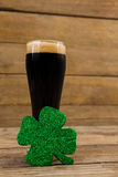 Glass of black beer and shamrock for St Patricks Day Stock Photography