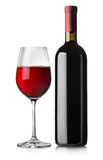 Glass and black bottle of red wine Stock Photography