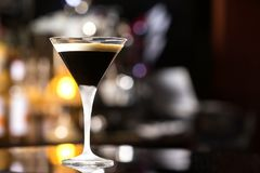 Glass of black russian cocktail at bar counter royalty free stock photo