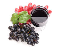 Glass of black wine and grapes Royalty Free Stock Images