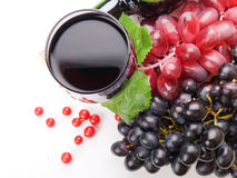 Glass of black wine and grapes Royalty Free Stock Photography