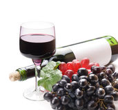 Glass of black wine and grapes Stock Images