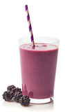 Glass of blackberry smoothie royalty free stock images
