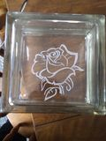 Glass block engraved by hand rose pattern stock photography