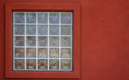 Glass block window red wall Stock Image