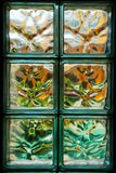 Glass blocks. Closeup of glass blocks on office wall with colourful pattern Stock Image