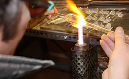 Glass blower. Glass blower forming a piece of decorative glass royalty free stock photos