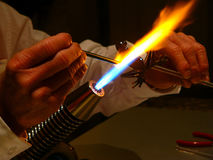 Glass Blower. A glass blower captured here making miniature animals stock photos
